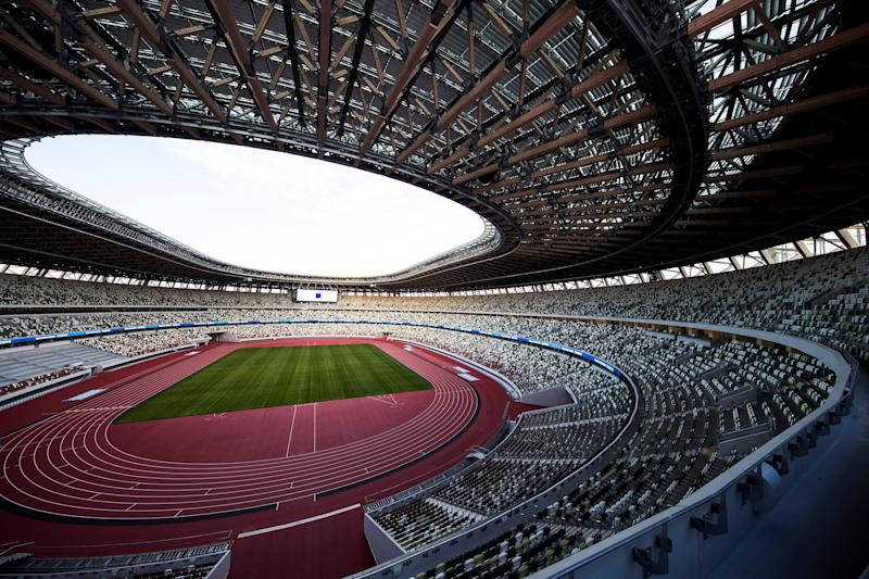 The National Stadium, venue for the upcoming Tokyo 2020 Olympic Games, is seen during a media tour following the the stadium's completion in Tokyo on December 15, 2019. - The Tokyo 2020 Olympics organisers on December 15 celebrated the completion of the main stadium that features use of lumber and other Japanese architectural tradition, seven months before the Opening Ceremony. (Photo by Behrouz MEHRI / AFP) (Photo by BEHROUZ MEHRI/AFP via Getty Images)