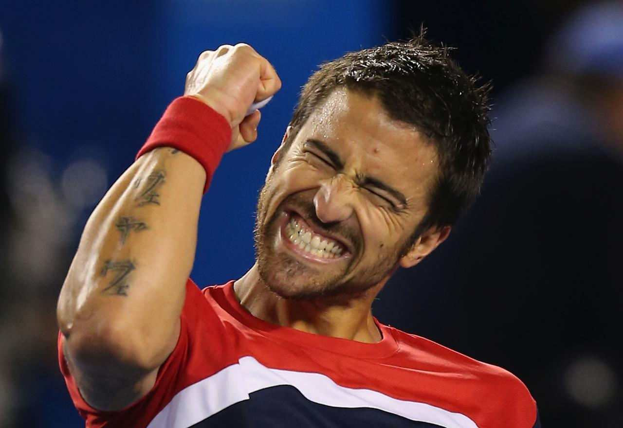 MELBOURNE, AUSTRALIA - JANUARY 14:  Janko Tipsarevic of Serbia celebrates winning his first round match against Lleyton Hewitt of Australia during day one of the 2013 Australian Open at Melbourne Park on January 14, 2013 in Melbourne, Australia. (Photo by Scott Barbour/Getty Images)