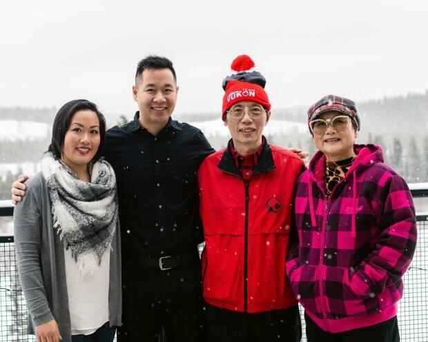 Mellisa Murray, left, with her family in Whitehorse. Murray's parents are from Hong Kong and she says growing up in Whitehorse she never fully understood what racism was even as she experienced it. (Submitted by Mellisa Murray - image credit)