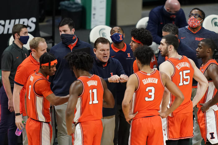 Illinois head coach Brad Underwood talks to his team during a timeout in the second half of an NCAA college basketball game against Michigan State, Tuesday, Feb. 23, 2021, in East Lansing, Mich. (AP Photo/Carlos Osorio)