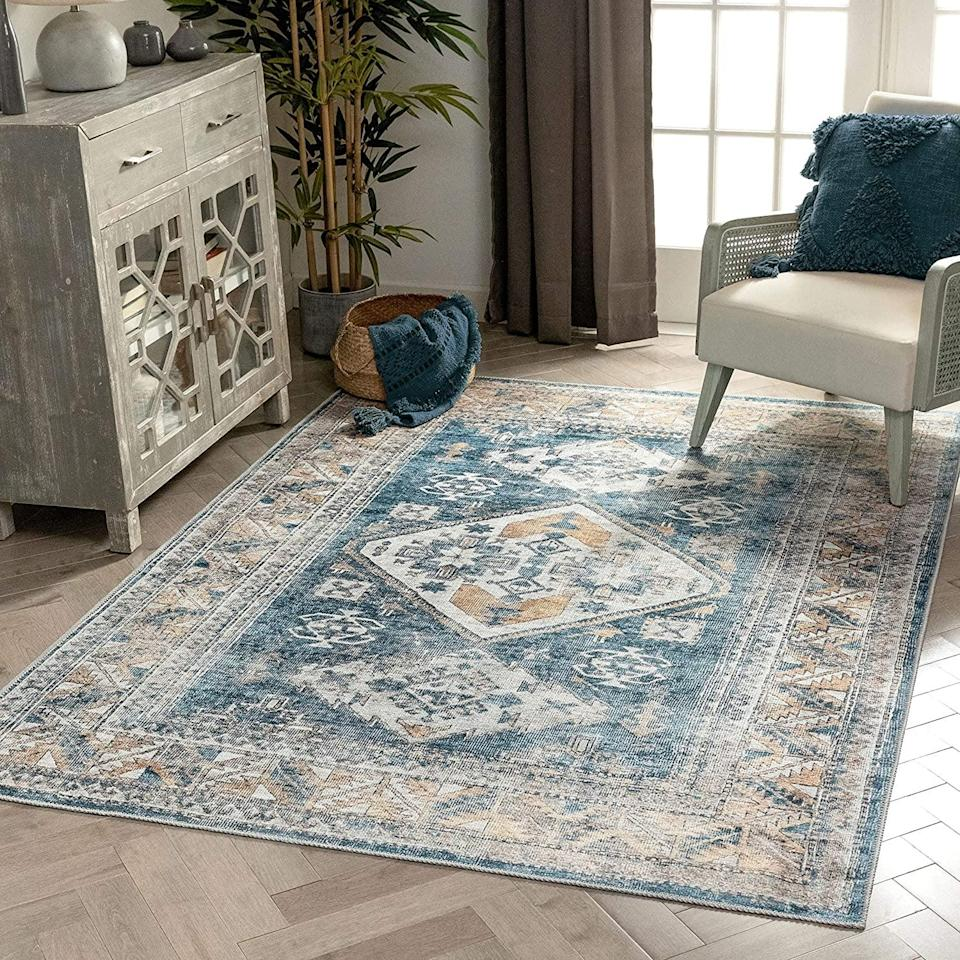 <p>Elevate your home office with this stunning <span>Well Woven Habra Light Blue Distsressed Persian Area Rug </span> ($179). It's a machine washable vintage-style rug that will add character and depth to your home office.</p>