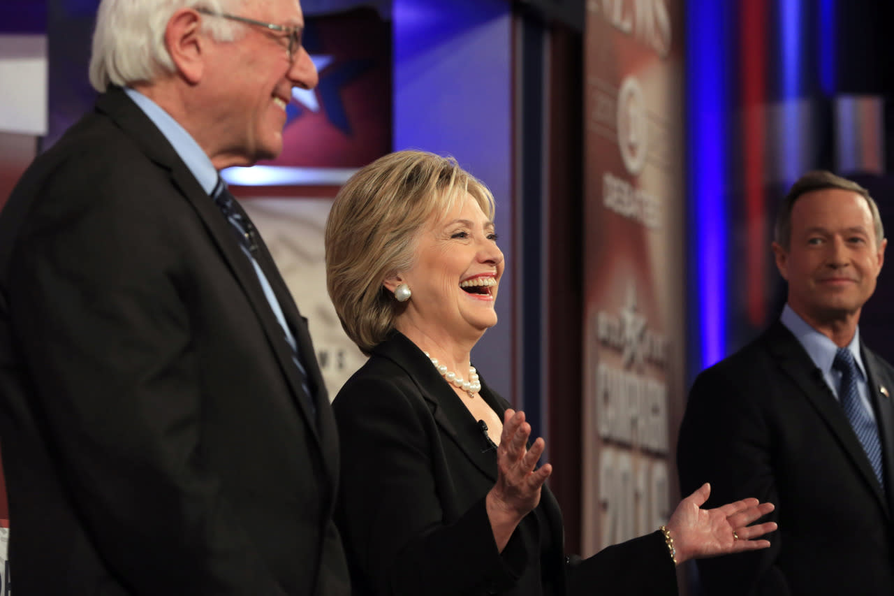 <p><i>Hillary Rodham Clinton laughs as she takes the stage with Bernie Sanders, left, and Martin O'Malley before the Democratic presidential primary debate on Saturday in Des Moines, Iowa. (Photo: Nati Harnik/AP)</i></p>