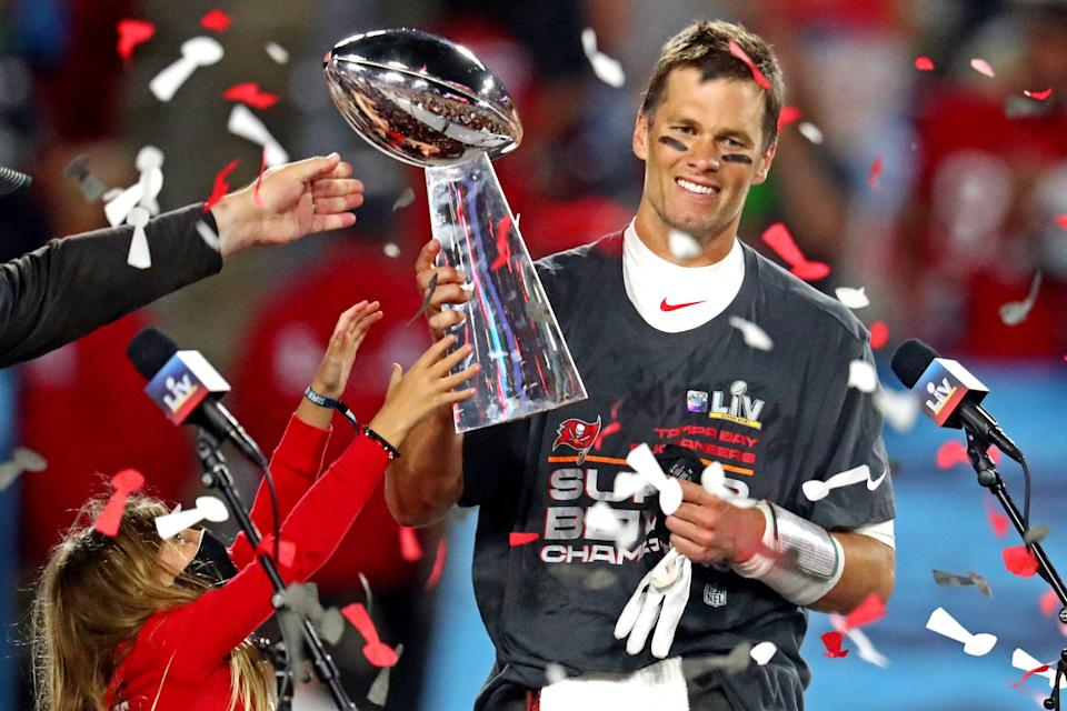 Tampa Bay Buccaneers quarterback Tom Brady  celebrates after beating the Kansas City Chiefs in Super Bowl 55.