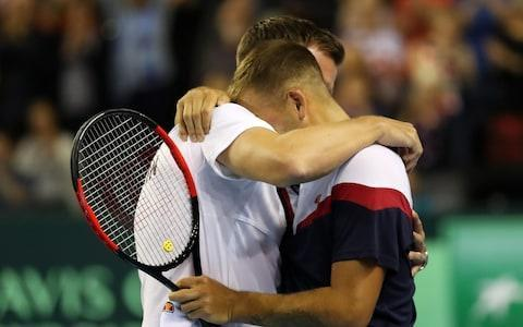 <span>Evans hugs team captain Leon Smith after his match</span> <span>Credit: Getty images </span>