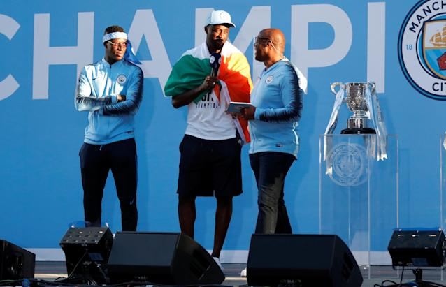 Soccer Football - Premier League - Manchester City Premier League Title Winners Parade - Manchester, Britain - May 14, 2018 Manchester City's Yaya Toure on stage during the parade Action Images via Reuters/Andrew Boyers
