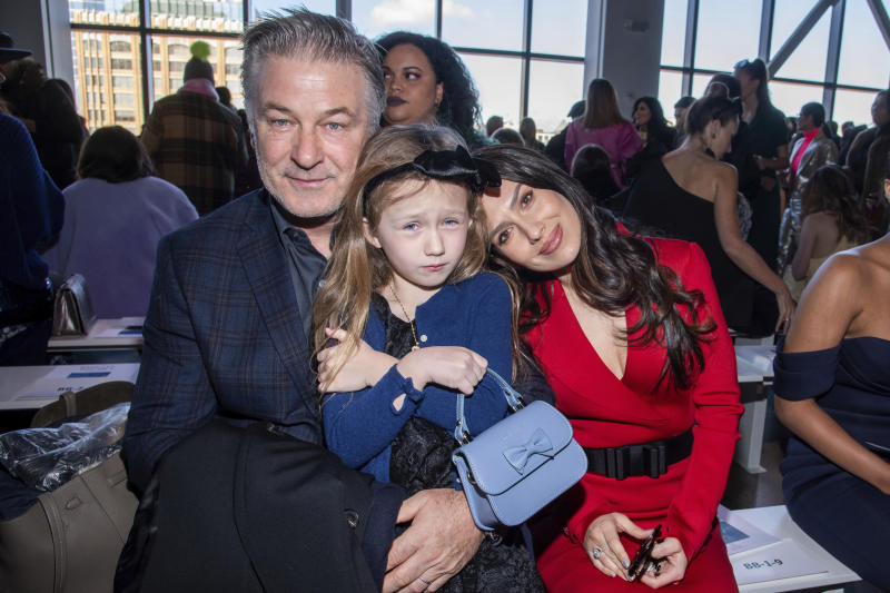 Alec Baldwin, from left, Carmen Baldwin and Hilaria Baldwin attend the Badgley Mischka fashion show at Spring Studios during NYFW Fall/Winter 2020 on Saturday, Feb. 8, 2020, in New York. (Photo by Charles Sykes/Invision/AP)