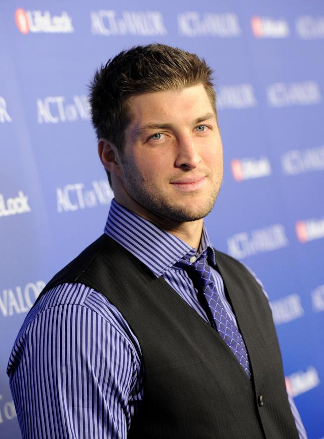 "HOLLYWOOD, CA - FEBRUARY 13: NFL Player Tim Tebow of the Denver Broncos arrives at the premiere of Relativity Media's ""Act Of Valor"" held at ArcLight Cinemas on February 13, 2012 in Hollywood, California. (Photo by Jason Merritt/Getty Images for Relativity Media)"