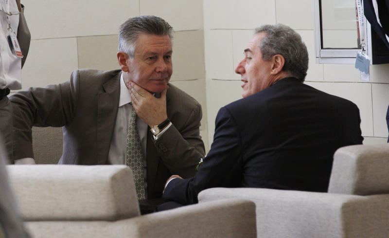 U.S. Trade Representative Michael Froman, right, talks with EU Trade Commissioner Karel De Gucht, left, at lobby before an informal meeting at the Ninth Ministerial Conference of the World Trade Organization (WTO) in Bali, Indonesia, Friday, Dec. 6, 2013. (AP Photo/Achmad Ibrahim)