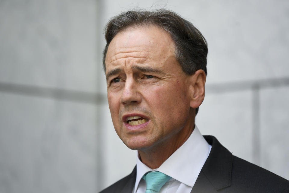 Australian Health Minister Greg Hunt speaks to the media during a press conference at Parliament House in Canberra, Tuesday, February 16, 2021.