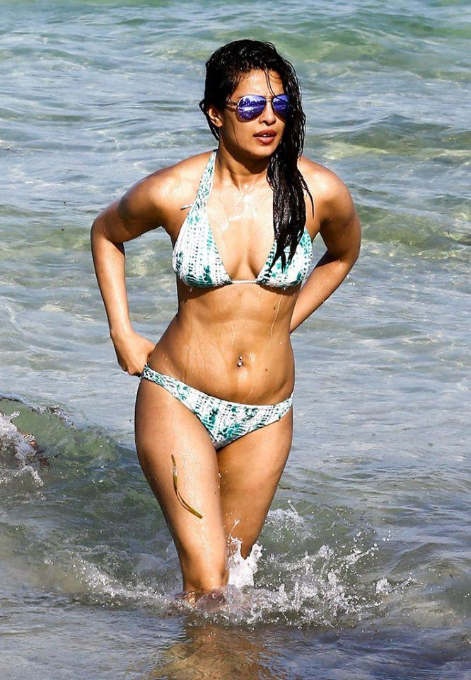 Priyanka Chopra wades in the water looking fit and fab. (Photo: Backgrid)