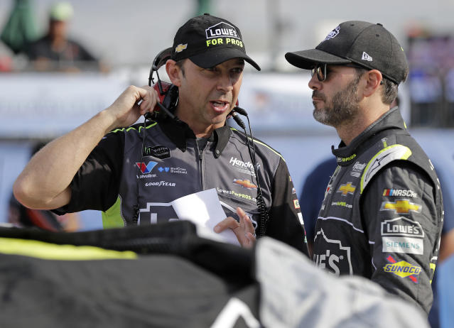 FILE - In this Friday, Sept. 28, 2018, file photo, Crew chief Chad Knaus, left, talks with driver Jimmie Johnson, right, before qualifying for the NASCAR Cup Series auto race at Charlotte Motor Speedway in Concord, N.C. There will be no eighth NASCAR title for Johnson and Knaus. Hendrick Motorsports will split the driver and crew chief at the end of this season, the team announced Wednesday, Oct. 10, 2018. (AP Photo/Chuck Burton, File)