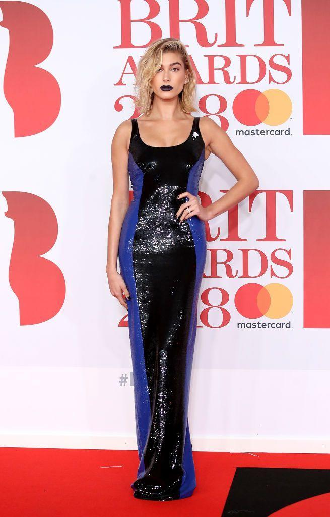 <p>The model went for vampy, dark lipstick to match her Ralph Lauren Collection black and blue sequinned gown at her first and only BRITs to date in 2018.</p>