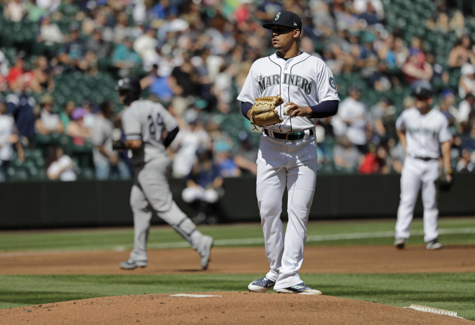 Seattle Mariners starting pitcher Justus Sheffield, center, stands on the mound as New York Yankees Gary Sanchez, left, rounds the bases after Sanchez hit a two-run home run during the first inning of a baseball game, Wednesday, Aug. 28, 2019, in Seattle. (AP Photo/Ted S. Warren)