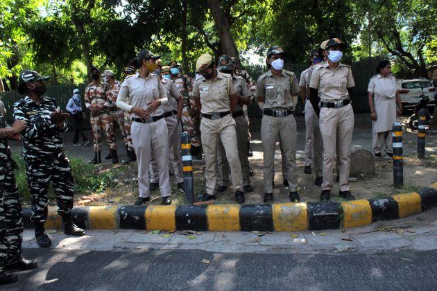 Security personnel are seen outside the Uttar Pradesh Bhawan during a demonstration in New Delhi on September 30, 2020, a day after a 19-year-old woman who was allegedly gang-raped died from her injuries in the Uttar Pradesh's Hathras. UP police is accused of forcibly cremating the body of a 19-year-old Dalit woman, who died in a Delhi hospital a fortnight after she was gangraped. (Photo by Mayank Makhija/NurPhoto via Getty Images)