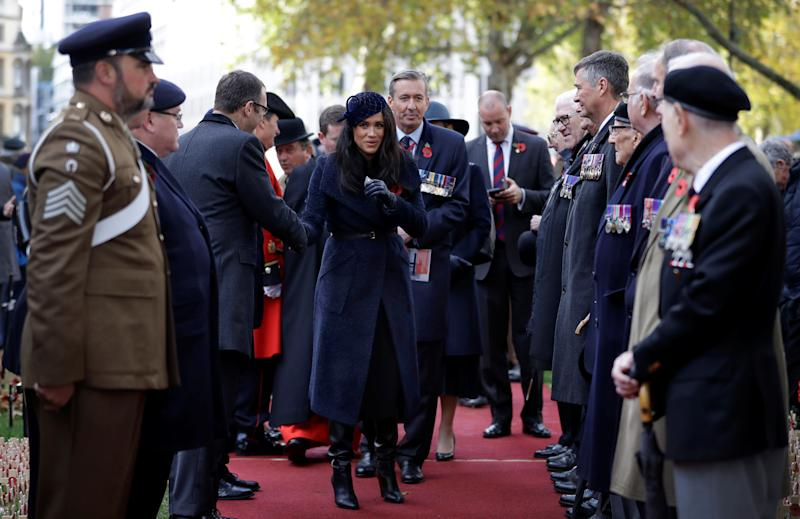 Britain's Meghan, the Duchess of Sussex meets veterans and soldiers as she attends the 91st Field of Remembrance at Westminster Abbey in London, Britain November 7, 2019. Kirsty Wigglesworth/Pool via REUTERS