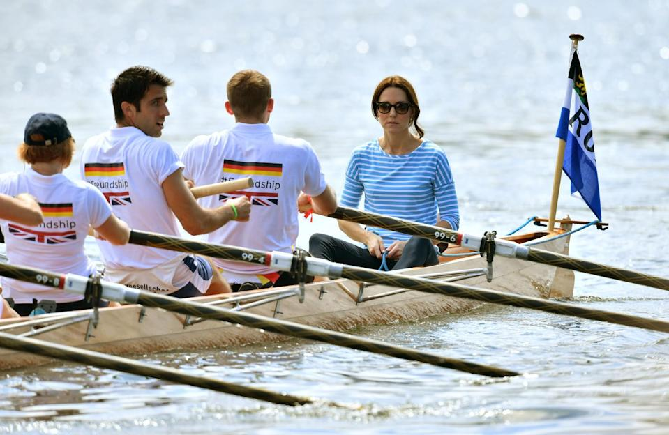 <p><b><b><b>Kate steers a boat against her husband, the Duke of Cambrige, in a competitive race between the twinned town of Cambridge and Heidelberg, Germany.<br><em>[Photo: PA]</em> </b></b></b></p>
