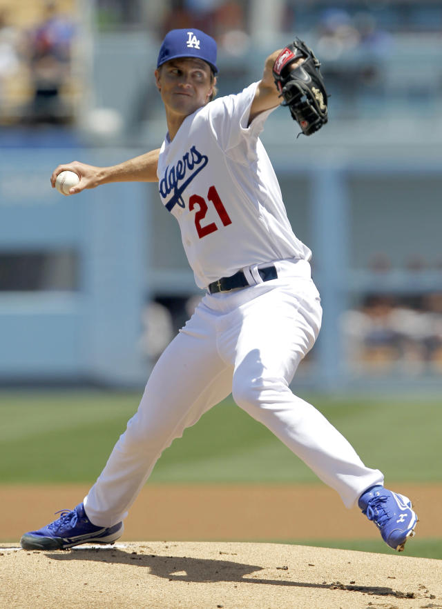 Los Angeles Dodgers starting pitcher Zack Greinke throws against the San Francisco Giants in the first inning of a baseball game on Saturday, May 10, 2014, in Los Angeles. (AP Photo/Alex Gallardo)
