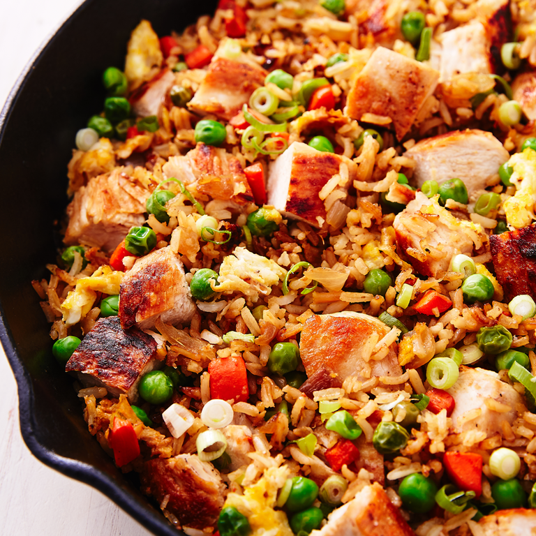 """<p>Chicken fried rice is the comfort dish of Chinese food. This classic take on the favourite is easy to make and makes the perfect lunch or dinner. </p><p>Get the <a href=""""https://www.delish.com/uk/cooking/recipes/a30119032/chicken-fried-rice-recipe/"""" rel=""""nofollow noopener"""" target=""""_blank"""" data-ylk=""""slk:Chicken Fried Rice"""" class=""""link rapid-noclick-resp"""">Chicken Fried Rice</a> recipe.</p>"""