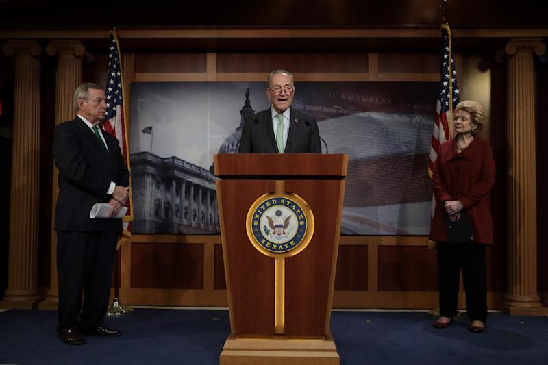 WASHINGTON, DC - MARCH 17: U.S. Senate Minority Leader Sen. Chuck Schumer (D-NY) speaks as Senate Minority Whip Sen. Richard Durbin (D-IL) and Sen. Debbie Stabenow (D-MI) listen during a news conference at the U.S. Capitol March 17, 2020 in Washington, DC. Senate Majority Leader Sen. Mitch McConnell said the Senate will pass the House coronavirus funding package in response to the outbreak of COVID-19. (Photo by Alex Wong/Getty Images)