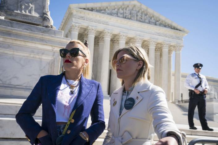 """<div class=""""inline-image__caption""""><p>Actors and activists Busy Philipps and Elizabeth Banks participate in an abortion rights rally outside of the Supreme Court as the justices hear oral arguments in the <em>June Medical Services v. Russo</em> case on March 4, 2020, in Washington, D.C. </p></div> <div class=""""inline-image__credit"""">Sarah Silbiger/Getty</div>"""