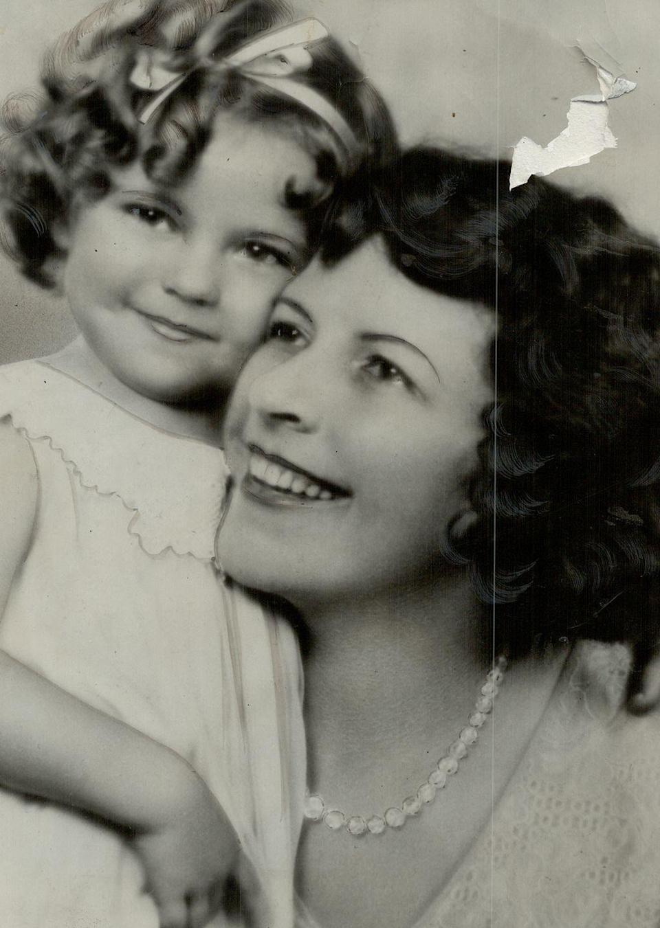 """<p>Shirley Temple was <a href=""""https://www.biography.com/actor/shirley-temple"""" rel=""""nofollow noopener"""" target=""""_blank"""" data-ylk=""""slk:born in 1928"""" class=""""link rapid-noclick-resp"""">born in 1928</a> in Santa Monica, California. The youngest of three children, her mother was a housewife, while her father worked as a banker. </p><p><strong>RELATED: </strong><a href=""""https://www.goodhousekeeping.com/life/g24274828/popular-child-star-year-you-were-born/"""" rel=""""nofollow noopener"""" target=""""_blank"""" data-ylk=""""slk:The Most Popular Child Star the Year You Were Born"""" class=""""link rapid-noclick-resp"""">The Most Popular Child Star the Year You Were Born</a></p>"""