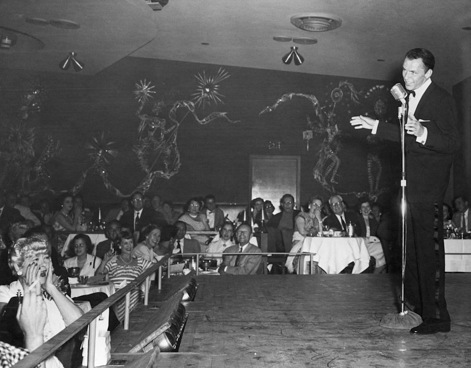 <p>Frank Sinatra performs at the Sands in 1954. He typically played at Sands three times a year, sometimes a two-week stint, which brought in a lot of business.</p>