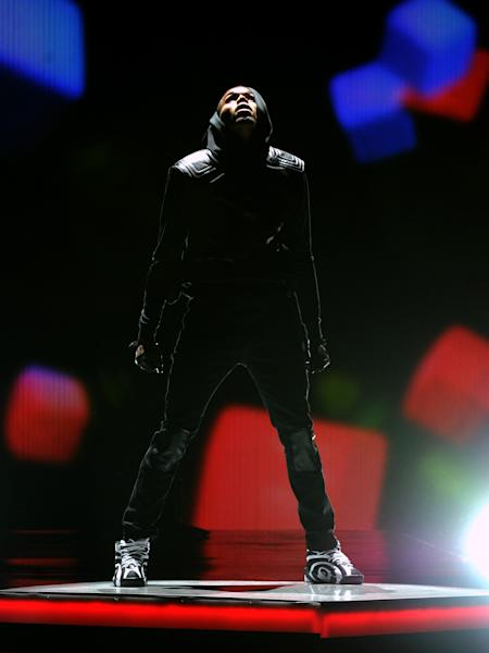 Chris Brown performs onstage at the BET Awards at the Nokia Theatre on Sunday, June 30, 2013, in Los Angeles. (Photo by Frank Micelotta/Invision/AP)