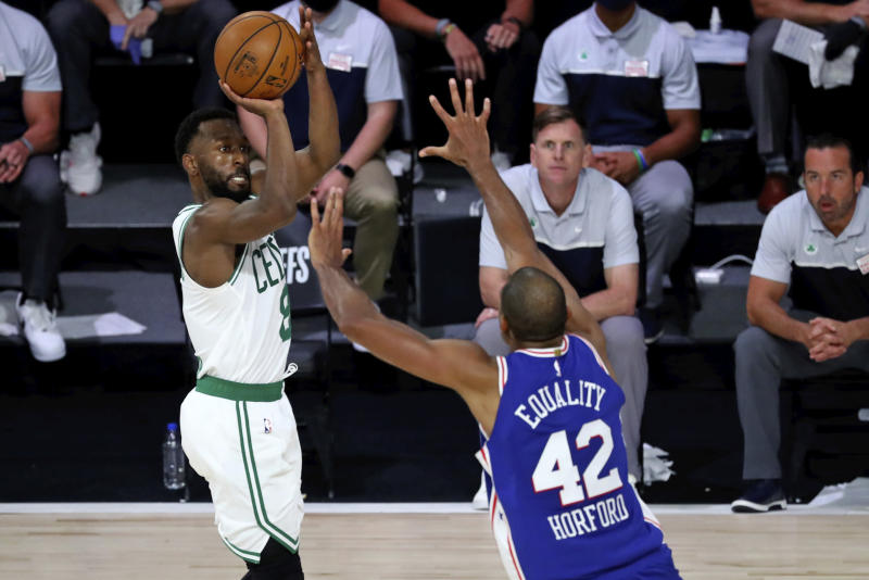 Boston Celtics guard Kemba Walker (8) shoots over Philadelphia 76ers forward Al Horford (42) during the second half in Game 3 of an NBA basketball first-round playoff series, Friday, Aug. 21, 2020, in Lake Buena Vista, Fla. (Kim Klement/Pool Photo via AP)