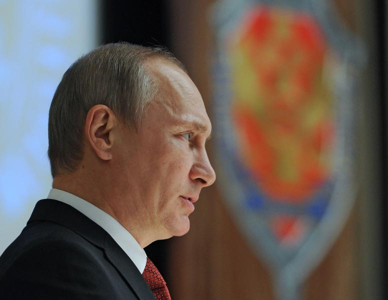 Russian President Vladimir Putin addresses employees of Federal Security Service ( FSB, Soviet KGB successor ) in Moscow on Monday, April 7, 2014. (AP Photo/RIA Novosti Kremlin, Mikhail Klimentyev, Presidential Press Service)