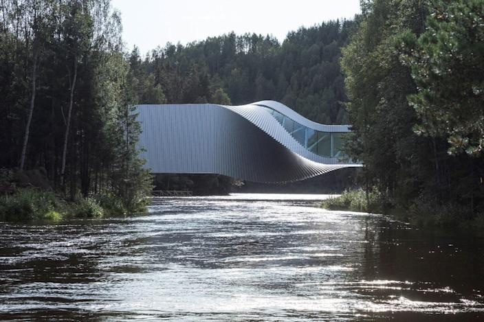 Completed in 2019, Bjarke Ingels Group's is three structures in one. Part museum, part bridge, and part sculpture, the nearly 11,000 square-foot art installation primarily acts as a bridge, connecting two forested riverbanks, while also completing the route through Kistefos, northern Europe's largest sculpture park.
