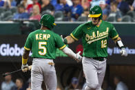 Oakland Athletics' Sean Murphy (12) is congratulated by teammate Tony Kemp after hitting a home run during the fifth inning of a baseball game against the Texas Rangers, Monday, June 21, 2021, in Arlington, Texas. (AP Photo/Sam Hodde)