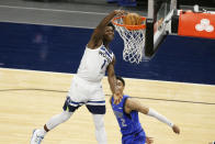 Minnesota Timberwolves forward Anthony Edwards (1) dunks in front of Dallas Mavericks guard Tyler Bey (2) in the fourth quarter of an NBA basketball game, Sunday, May 16, 2021, in Minneapolis. The Timberwolves defeated the Mavericks 136-121. (AP Photo/Andy Clayton-King)