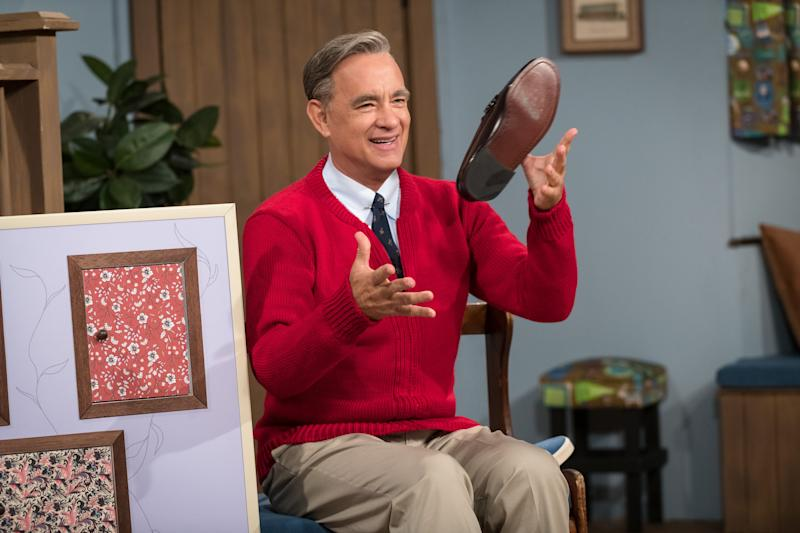 Mr. Rogers (Tom Hanks) changes his shoes in trademark fashion in
