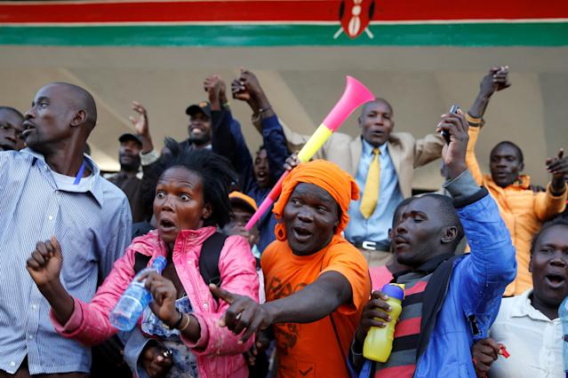 <p>Supporters cheer as they wait for Kenyan opposition leader Raila Odinga of the National Super Alliance (NASA) coalition to be sworn in as the President of the People's Assembly at Uhuru Park in Nairobi, Kenya, Jan. 30, 2018. (Photo: Baz Ratner/Reuters) </p>