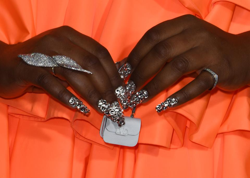 US singer/songwriter Lizzo (detail bag) arrives for the 2019 American Music Awards at the Microsoft theatre on November 24, 2019 in Los Angeles. (Photo by Mark RALSTON / AFP) (Photo by MARK RALSTON/AFP via Getty Images)