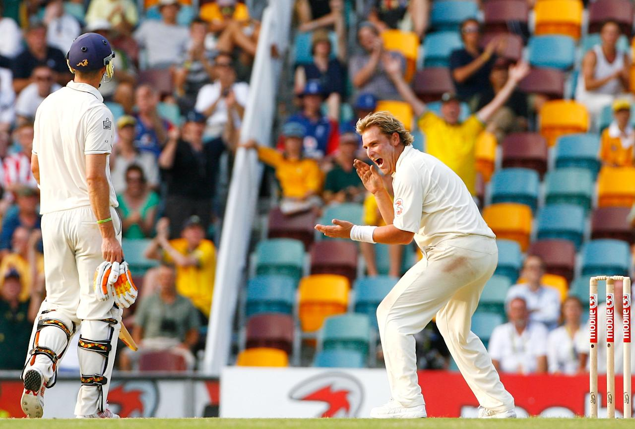 BRISBANE, AUSTRALIA - NOVEMBER 26:  Shane Warne of Australia celebrates dismissing Andrew Flintoff of England as Kevin Pietersen of England looks on during day four of the first Ashes Test Match between Australia and England at The Gabba on November 26, 2006 in Brisbane, Australia.  (Photo by Tom Shaw/Getty Images)