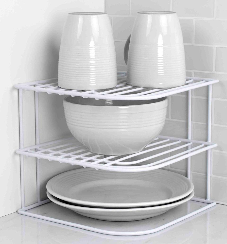 <p>Make use of the corner spaces in your cabinets with this <span>Vinyl Shelving RackVinyl Shelving Rack</span> ($16). It's great for stacking plates, mugs, bowls, and more.</p>