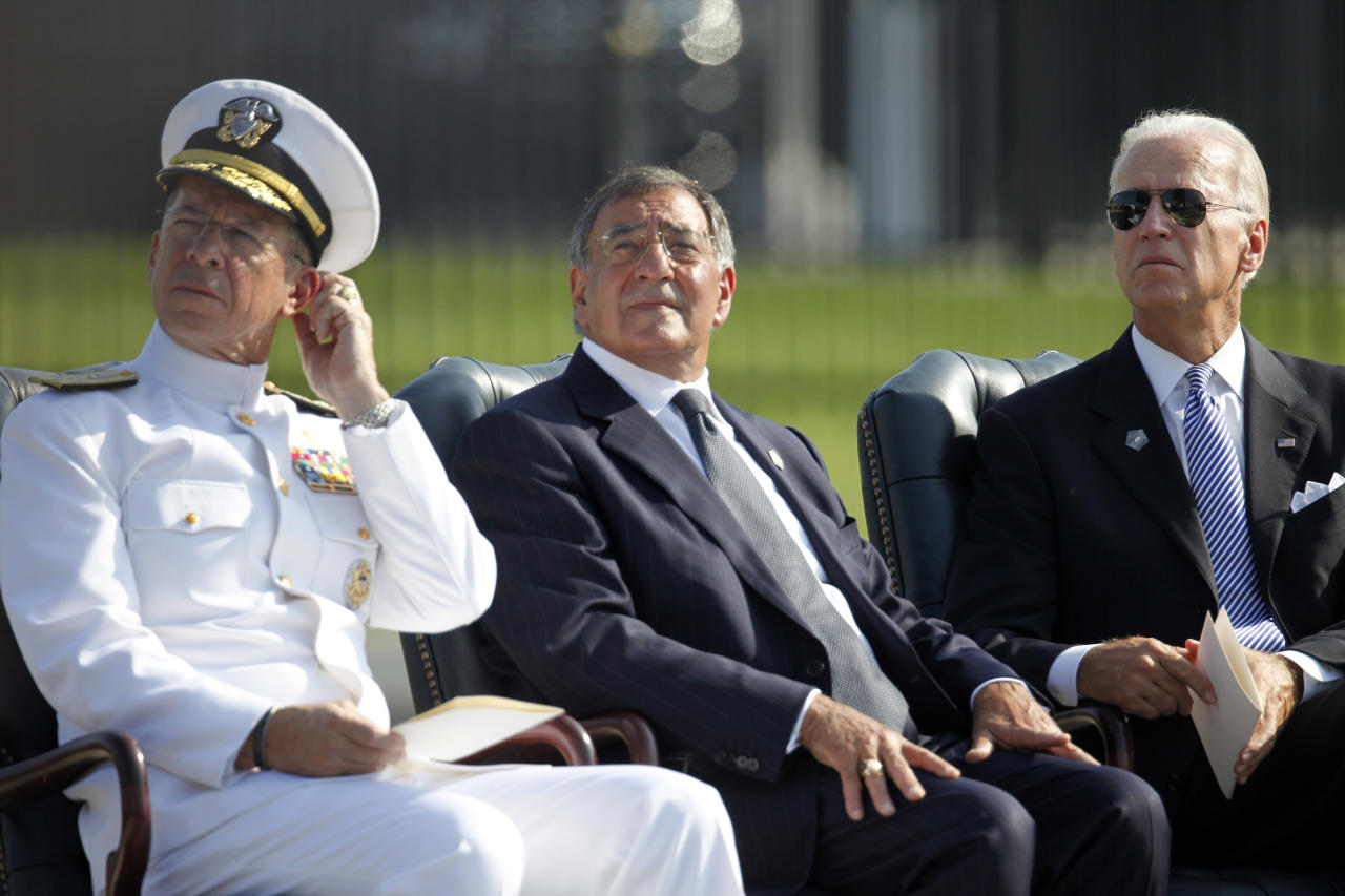 Vice President Joe Biden, from right, Defense Secretary Leon Panetta, and Chairman of the Joint Chiefs of Staff Adm. Mike Mullen participate in commemorative ceremony to honor vicitms of the Sept. 11 attacks during the 10th anniversary at the Pentagon in Washington, Sunday, Sept. 11, 2011.  (AP Photo/Charles Dharapak)