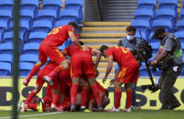 Wales' Neco Williams is mobbed by his team-mates as he celebrates scoring his side's first goal of the game against Bulgaria, during their UEFA Nations League Group 4 soccer match at Cardiff City Stadium in Cardiff, Wales, Sunday Sept. 6, 2020. (David Davies/PA via AP)