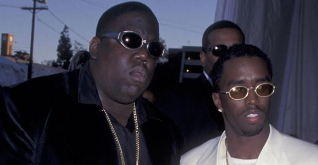 Combs with Wallace on the day of Wallace's assassination in 1997. (Getty Pictures)