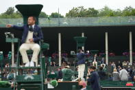 Umpires sit on their chairs on the outside courts on day three of the Wimbledon Tennis Championships in London, Wednesday June 30, 2021. (AP Photo/Alberto Pezzali)