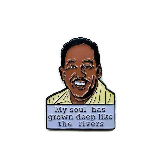 """<h2>Langston Hughes Soft Enamel Pin</h2><br>Langston Hughes is a writing legend from the Harlem-Renaissance and his poetry still stands today. If your gift receiver is a fan of old-school Black poets then this is a great little gift. <br><br><em>Shop</em> <strong><em><a href=""""https://fave.co/31sHYgx"""" rel=""""nofollow noopener"""" target=""""_blank"""" data-ylk=""""slk:Reformed School"""" class=""""link rapid-noclick-resp"""">Reformed School</a></em></strong><br><br><strong>ReformedSchool</strong> Langston Hughes - Soft Enamel Pin, $, available at <a href=""""https://go.skimresources.com/?id=30283X879131&url=https%3A%2F%2Ffave.co%2F2HiNZVU"""" rel=""""nofollow noopener"""" target=""""_blank"""" data-ylk=""""slk:Etsy"""" class=""""link rapid-noclick-resp"""">Etsy</a>"""