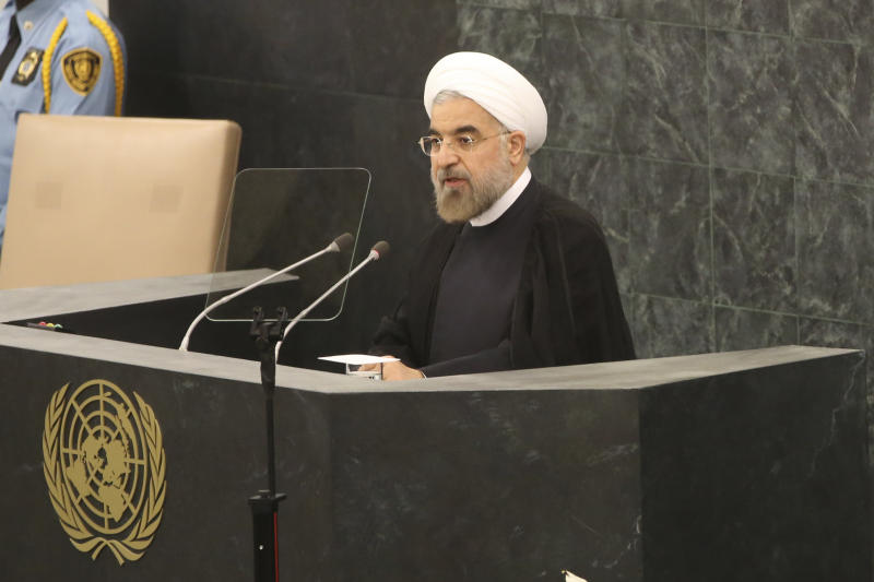 Iranian President Hasan Rouhani addresses the 68th session of the United Nations General Assembly, Tuesday, Sept. 24, 2013 at U.N. headquarters. (AP Photo/Mary Altaffer)
