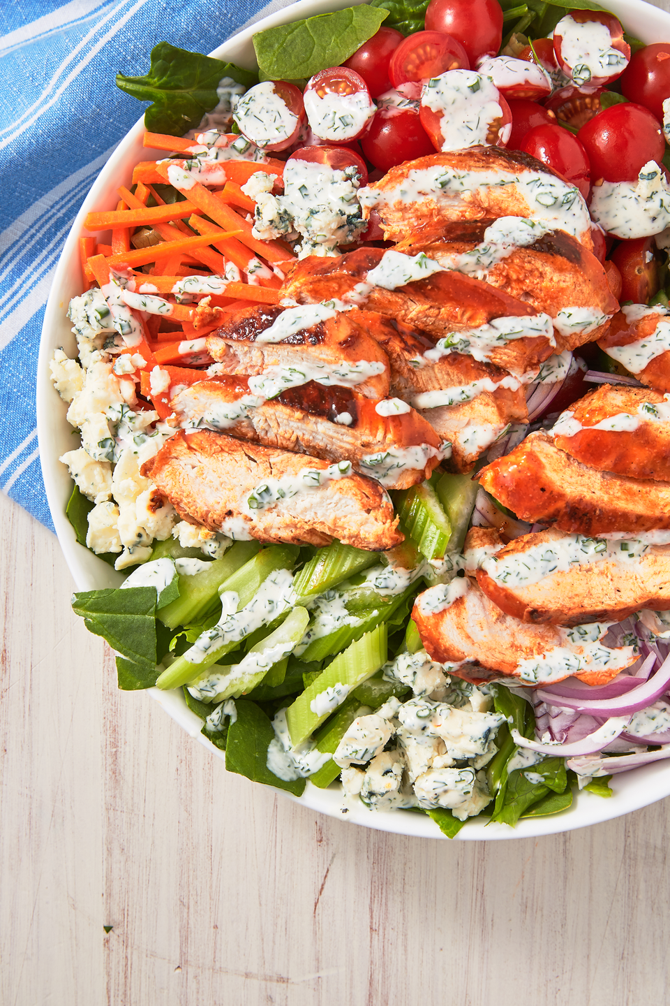 """<p>Buffalo wings but make it healthy.<br></p><p>Get the recipe from <a href=""""https://www.delish.com/cooking/recipe-ideas/a27925036/easy-buffalo-chicken-salad-recipe/"""" rel=""""nofollow noopener"""" target=""""_blank"""" data-ylk=""""slk:Delish"""" class=""""link rapid-noclick-resp"""">Delish</a>. </p>"""