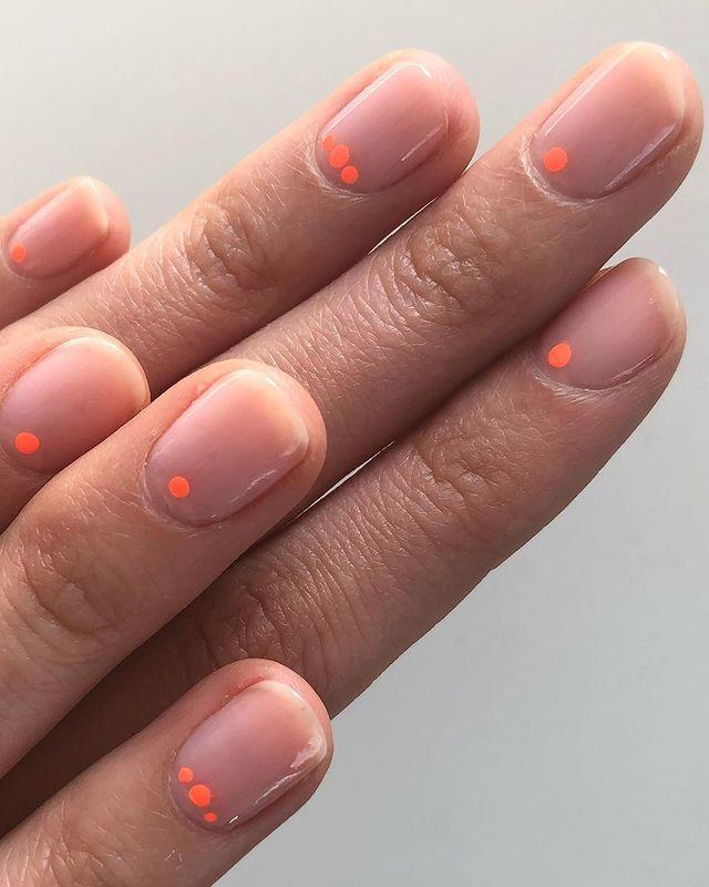 """<p>Use a nail dotting tool to add a circle of neon to your otherwise nude manicure.</p><p><a href=""""https://www.instagram.com/p/Bizv9oIA7ep/"""" rel=""""nofollow noopener"""" target=""""_blank"""" data-ylk=""""slk:See the original post on Instagram"""" class=""""link rapid-noclick-resp"""">See the original post on Instagram</a></p>"""