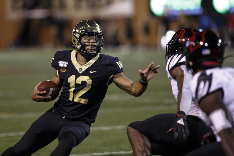 Wake Forest quarterback Jamie Newman (12) carries the football against Louisville during the first half of an NCAA college football game in Winston-Salem, N.C., Saturday, Oct. 12, 2019. (AP Photo/Nell Redmond)