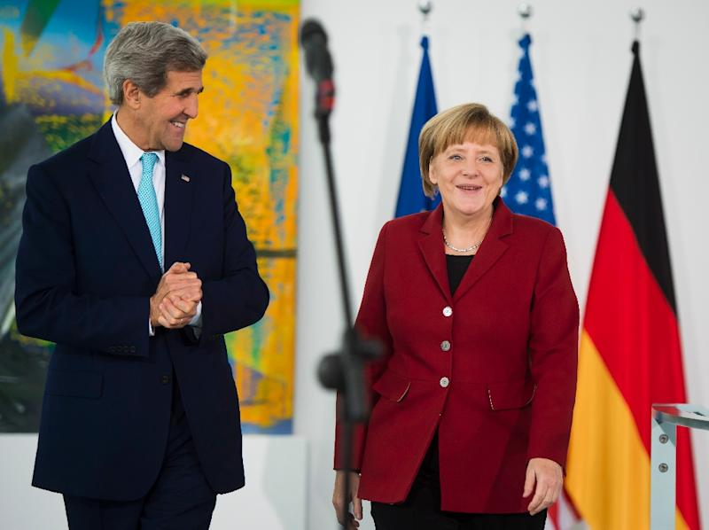 "Outgoing US Secretary of State John Kerry (L) called German leader Angela Merkel ""courageous"""
