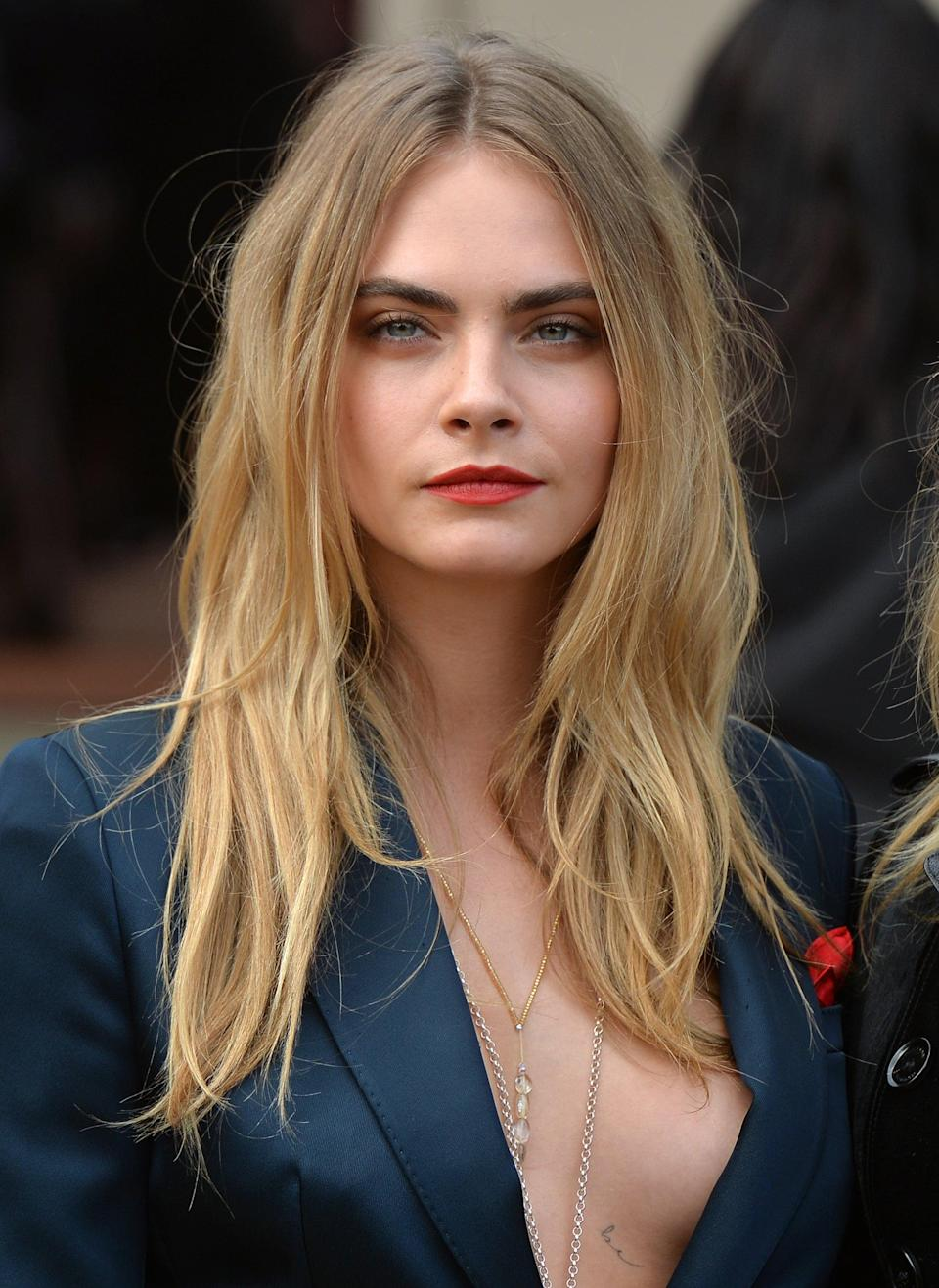 <p>A middle part and very laid-back waves were the perfect combination to best accentuate Delevingne's ombré hair color, which went from ash blond at the roots to a brighter, more golden hue toward the ends. </p>