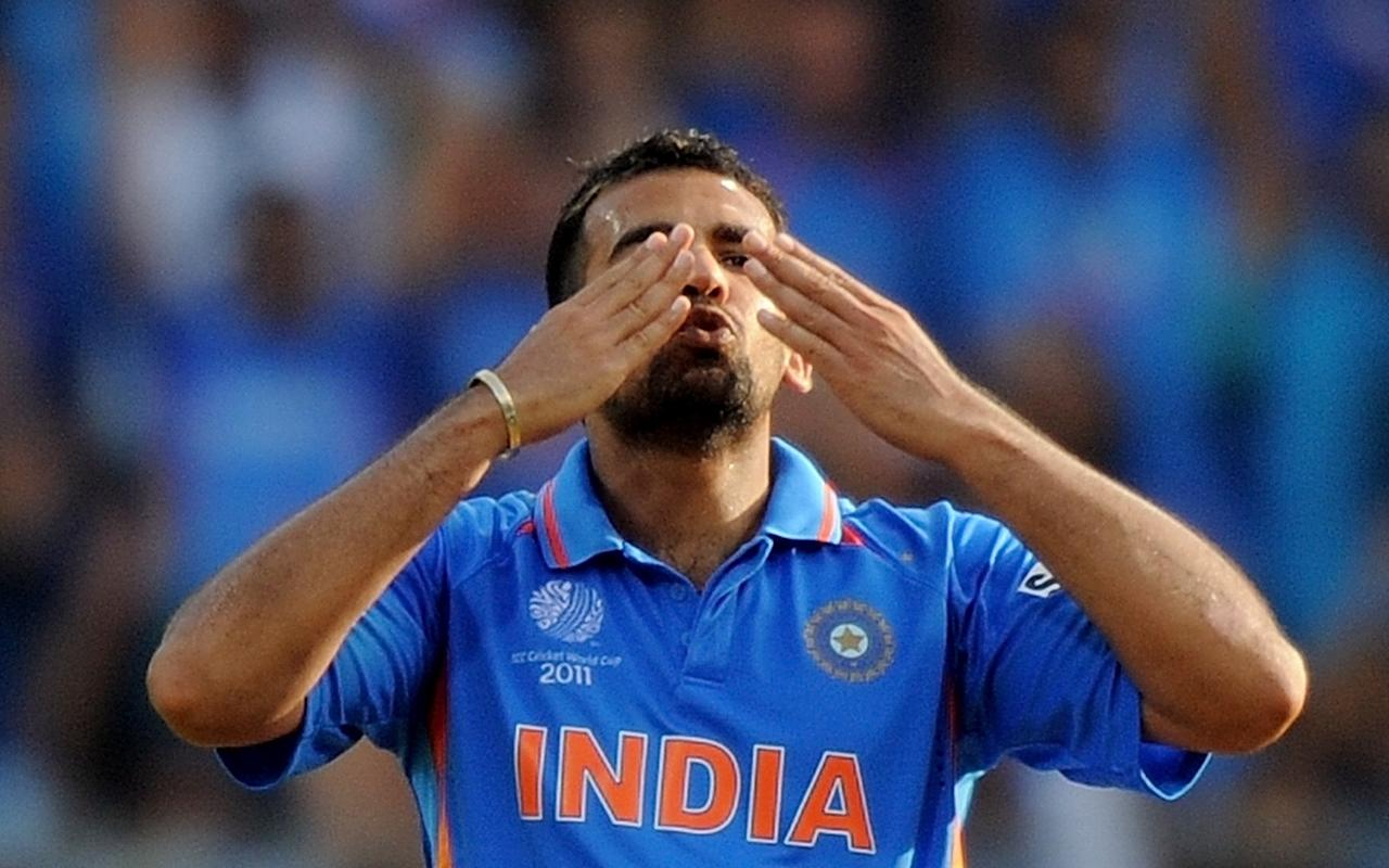 Indian fastbowler Zaheer Khan reacts after taking the wicket of Sri Lankan batsman Chamara Kapugedera during the ICC Cricket World Cup 2011 final match at The Wankhede Stadium in Mumbai on April 2, 2011.   AFP PHOTO/MANAN VATSYAYANA (Photo credit should read MANAN VATSYAYANA/AFP/Getty Images)