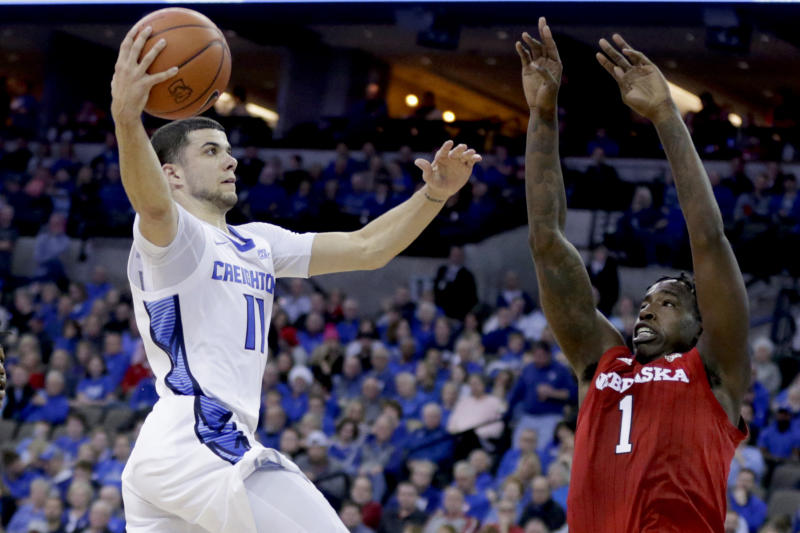 Creighton's Marcus Zegarowski (11) goes to the basket against Nebraska's Kevin Cross (1) during the first half of an NCAA college basketball game in Omaha, Neb., Saturday, Dec. 7, 2019. (AP Photo/Nati Harnik)